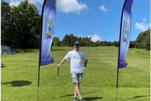 Golfer Chris raises a wedge for GYC!